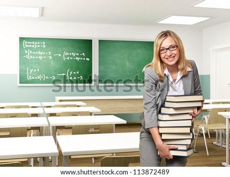 portrait of smiling teacher holding books - stock photo