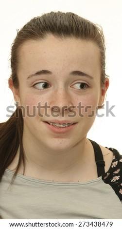 Portrait of Smiling Teen girl showing dental braces - stock photo