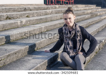 Portrait of Smiling Teenage Caucasian Girl on Stairs. Horizontal Image Orientation - stock photo