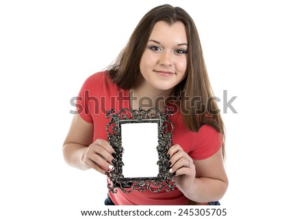 Portrait of smiling teenage girl with photo frame on white background - stock photo
