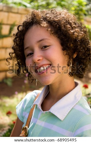 Portrait of smiling teenager girl outdoor.