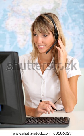 Portrait of smiling teleoperator with headset - stock photo