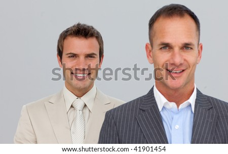 Portrait of smiling two businessmen with folded arms - stock photo