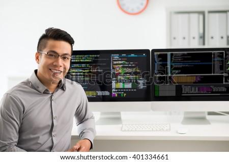 Portrait of smiling Vietnamese software engineer - stock photo