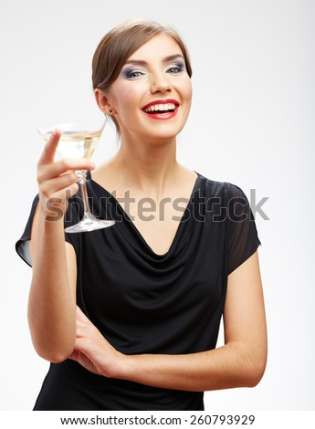 Portrait of smiling woman holding glass with drink. Girl celebrating event isolated portrait. - stock photo
