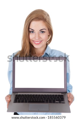 Portrait Of Smiling Woman Holding Laptop Over White Background