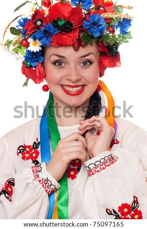 Portrait of smiling woman in the Ukrainian national clothes - stock photo