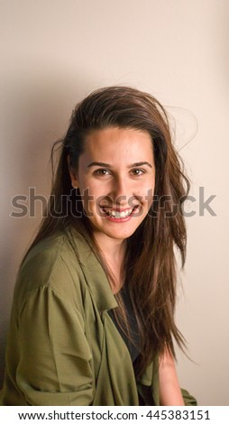 Portrait of smiling woman isolated on background, close-up