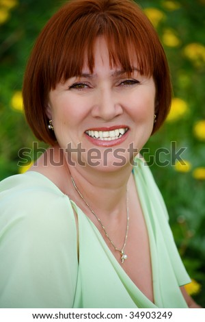 Portrait of smiling woman looking at camera - stock photo