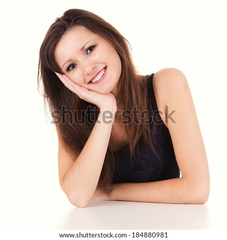 Portrait of smiling woman resting her chin on hand, white background. - stock photo