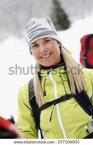 Portrait of smiling woman skiing, Vasterbotten, Lapland, Sweden - stock photo