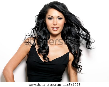 Portrait of smiling woman with beauty long brown hair - posing at studio - stock photo