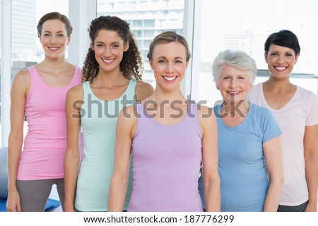 Portrait of smiling women standing in the yoga class