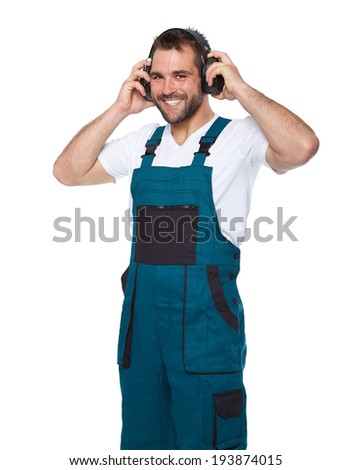Portrait of smiling worker in green uniform with protective earphones isolated on white background  - stock photo