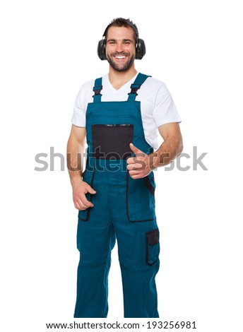 Portrait of smiling worker in uniform with protective earphones isolated on white background