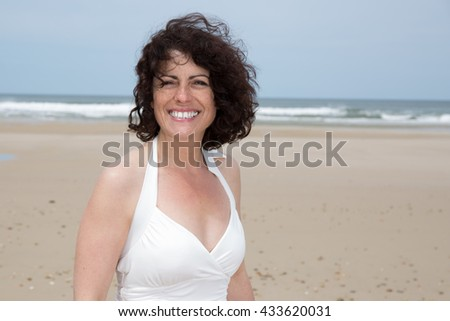 Portrait of smiling 40-year-old brunette woman - stock photo
