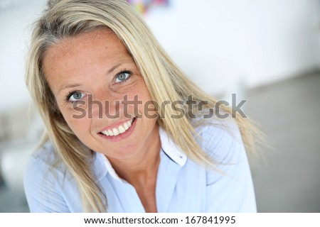 Portrait of smiling 40 year old woman - stock photo