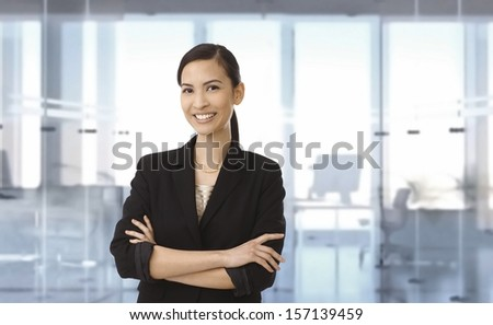 Portrait of smiling young asian businesswoman at office. Space for text. - stock photo