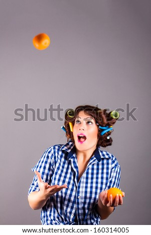portrait of smiling young attractive girl with oranges - stock photo