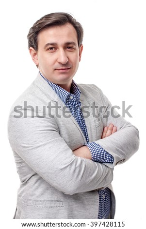 Portrait of smiling young business man in white coat - stock photo