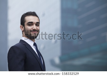 Portrait of smiling young businessman - stock photo