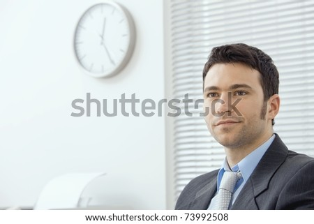 Portrait of smiling young businessman at office.? - stock photo