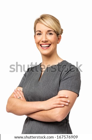 Portrait of smiling young businesswoman with arms crossed isolated over white background. Vertical shot.