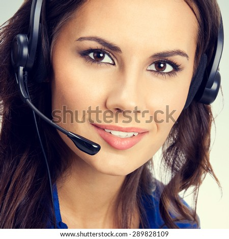 Portrait of smiling young female support phone operator or businesswomen in headset. Customer service concept. - stock photo
