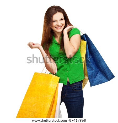 Portrait of smiling young female with shopping bags against white background - stock photo