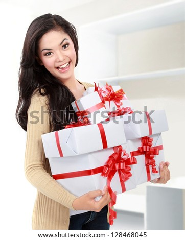 portrait of smiling young girl bring some gift - stock photo