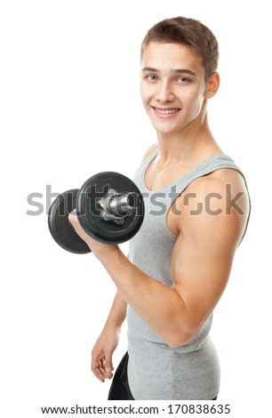 Portrait of smiling young man bodybuilder exercising with dumbbells for training his biceps isolated on white background