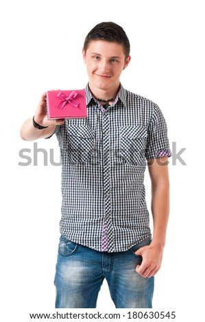 Portrait of smiling young man holding gift, isolated on white background