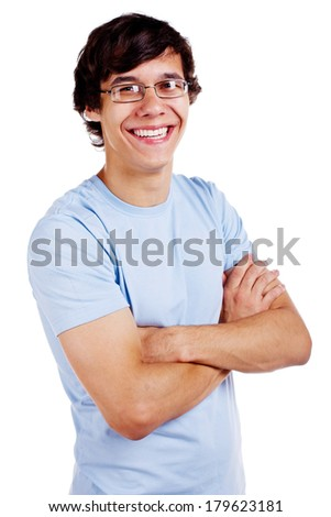Portrait of smiling young man in glasses and blue shirt with crossed arms on his chest isolated on white background - stock photo