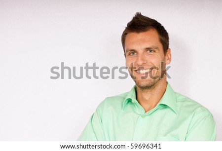Portrait of smiling young man. You can write text on left side. - stock photo