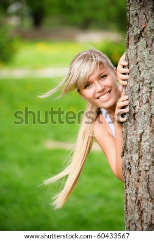 Portrait of smiling young woman close up on green background. - stock photo