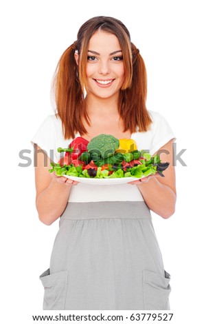 portrait of smiling young woman holding vegetables. isolated on white background - stock photo