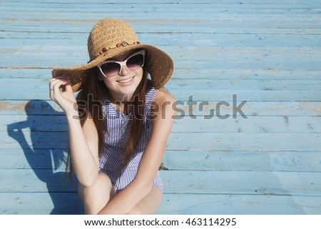 Portrait of smiling young woman on the beach on the bright color