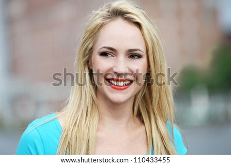 Portrait of smiling young woman Portrait of smiling young woman under natural light - stock photo