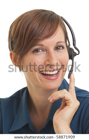 Portrait of smiling young woman telemarketer with hand on headset - stock photo