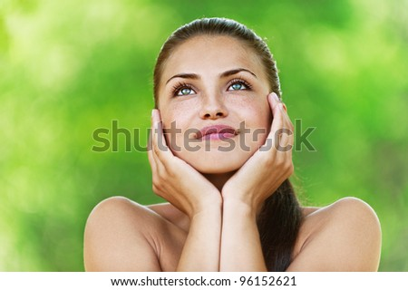 Portrait of smiling young woman with bared shoulders. - stock photo