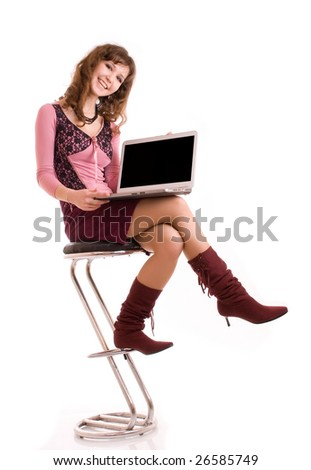 Portrait of smiling young woman working on laptop - stock photo