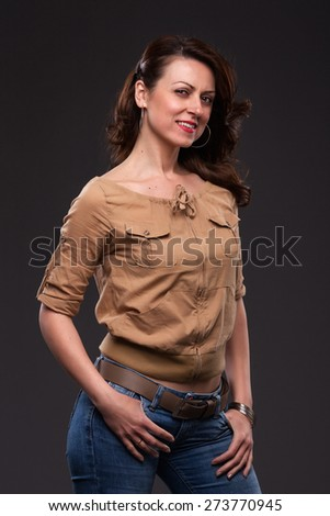 Portrait of smilling middle-aged woman in jeans. - stock photo