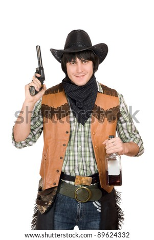 Portrait of smirking cowboy with a gun and bottle of whiskey in hands - stock photo