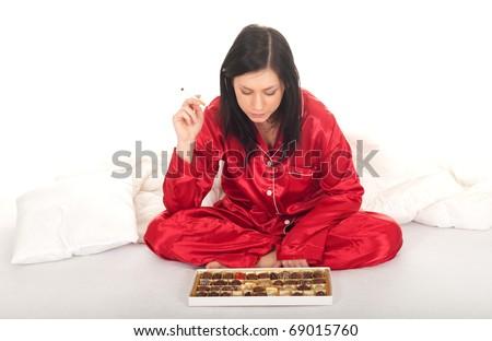 portrait of smoking woman holding chocolate box - stock photo