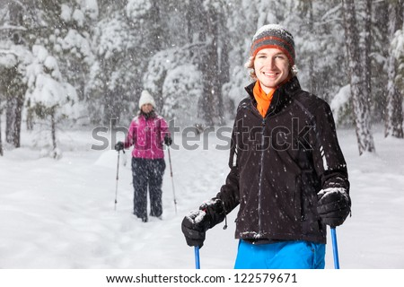 Portrait of Snowshoer (With Second Snowshoer in the Background) - stock photo