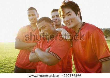 Portrait of soccer team - stock photo