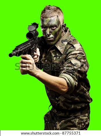 portrait of soldier aiming with gun against a removable chroma key background - stock photo