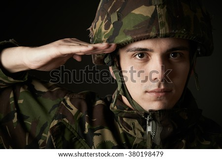 Portrait Of Soldier In Uniform Saluting - stock photo