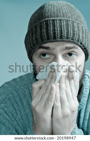 Portrait of sore man infected with flu virus - stock photo