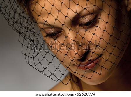 Portrait of sorrowful widow in black veil - stock photo